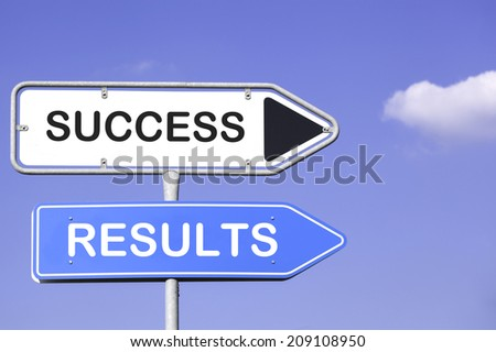blue sky behind two white and blue road signs  on a metal mast with arrows to the right hand side showing the way to success and results - stock photo