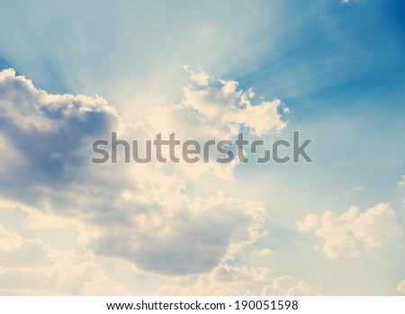 blue sky, clouds and sun behind the clouds, sun, sunrise and sunset, instagram effect - stock photo