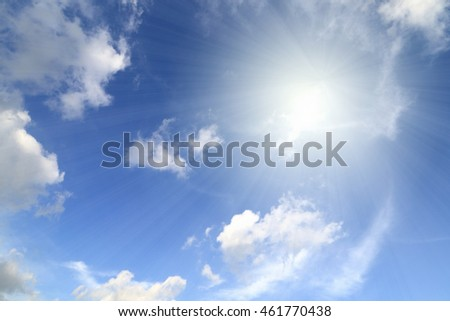 blue sky, clouds, sun shining with ray