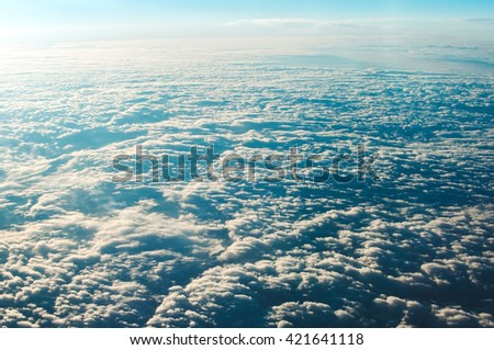 blue sky clouds view from aircraft airplane in the morning - stock photo