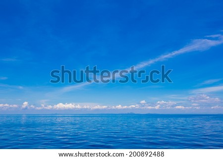 Blue sky expanse of the sea and white clouds, sea scape - stock photo