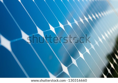 Blue Sky is reflected on the solar panels - stock photo