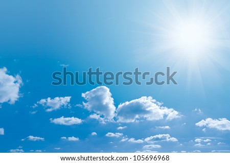 Blue sky light clouds and a bright Sun - stock photo