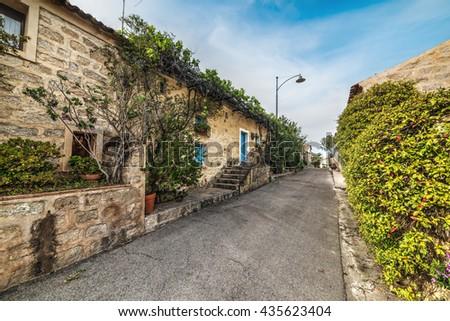 blue sky over a narrow street in San Pantaleo, Sardinia - stock photo