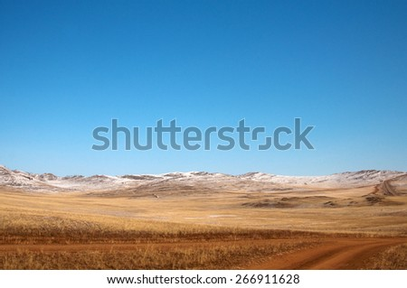 blue sky over the vast  steppes, Olkhon island, Baikal.  Used toning of the photo.   - stock photo