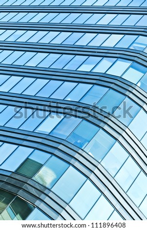 Blue sky reflected in the glass building - stock photo