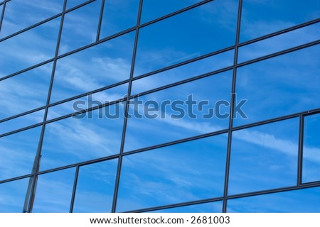 Blue sky reflecting itself in a building - stock photo