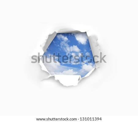 blue sky through a hole in paper - stock photo