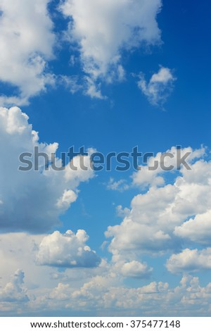 Blue sky vertical background with white clouds. Blue clear sky panorama with cloud closeup. - stock photo
