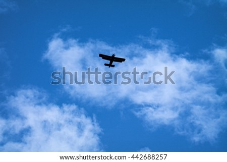 blue sky, white clouds, airplane silhouette