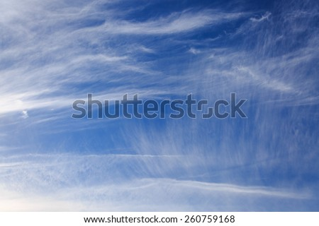 Blue sky with bright fluffy clouds - stock photo