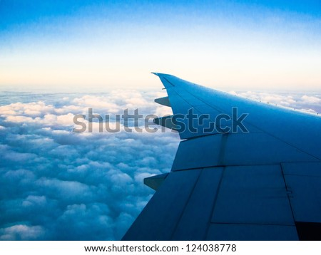 Blue Sky with Clouds-An aerial view from an airplane - stock photo