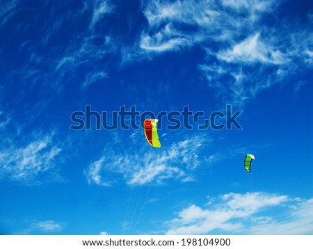 Blue sky with clouds and kites - stock photo