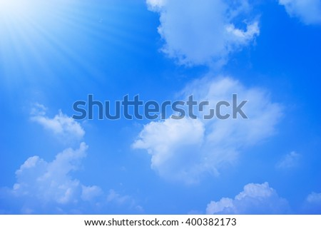 Blue sky with clouds and light of the sun.