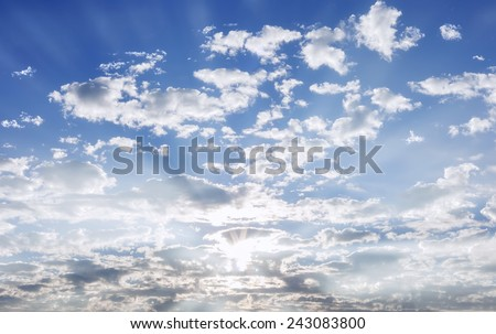 Blue sky with clouds and sun lighting . - stock photo