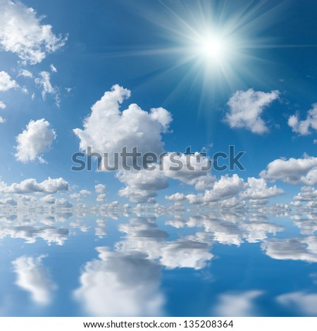 Blue sky with clouds and sun reflection in water, for design