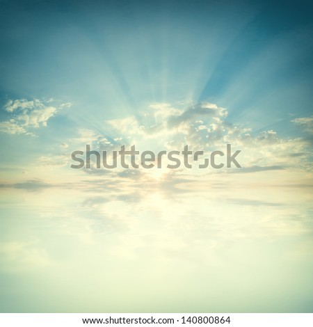 Blue sky with clouds and sun reflection in water with place for your text - stock photo