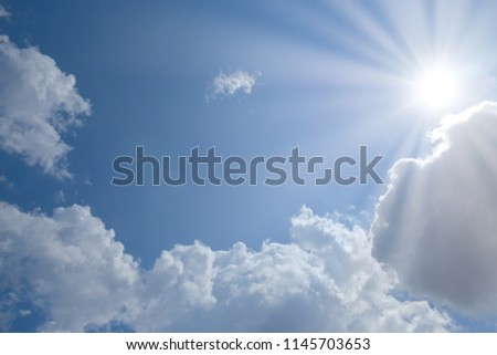 Blue sky with clouds and sun with place for your text, copyspace