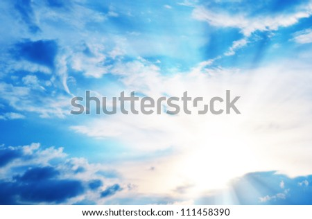Blue sky with clouds and sunlight. - stock photo