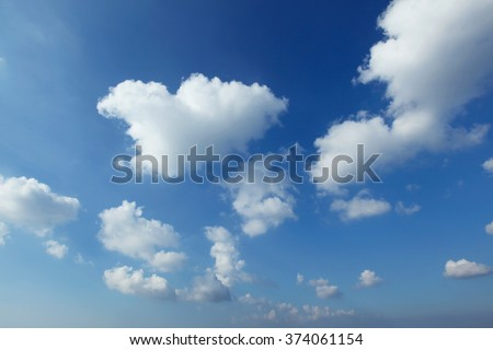 Blue sky with clouds at sunny day - stock photo