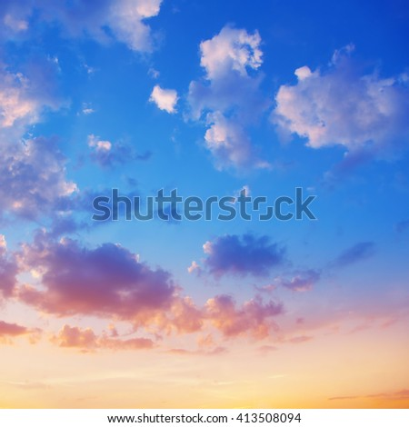 Blue sky with clouds at sunset. - stock photo