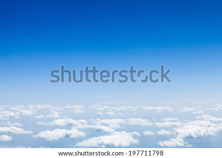Blue sky with clouds background with copy space. View from airplane - stock photo