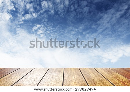 Blue sky with clouds background ,wood textured background - stock photo