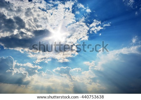 Blue sky with clouds. Blue sky with sunray.  - stock photo
