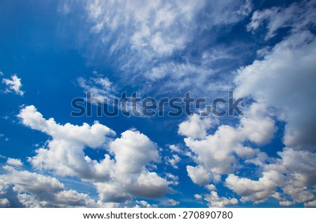 Blue sky with clouds closeup, summer day - stock photo