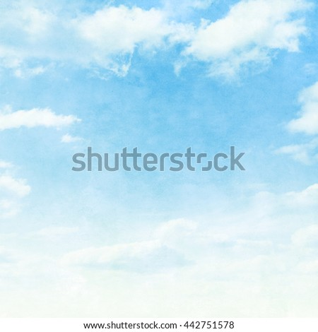 Blue sky with clouds in grunge style with noise.