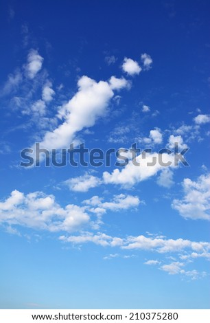 Blue sky with clouds, may be used as background - stock photo