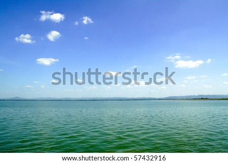 Blue sky with clouds over Lake - stock photo