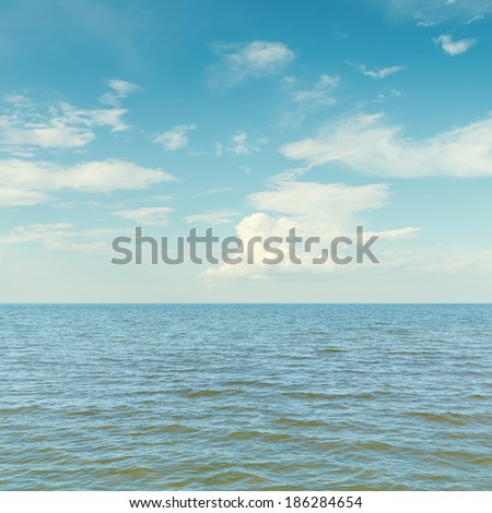blue sky with clouds over sea - stock photo