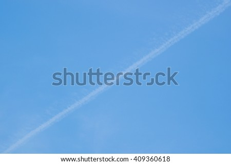 Blue Sky with Condensation Trail background