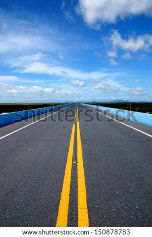Blue sky with could,  Empty road and the traffic lines.