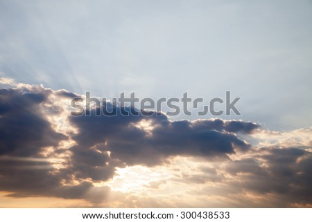 Blue sky with dramatic colorful clouds and percolating light on the sun - rays. Concept for environmental protection