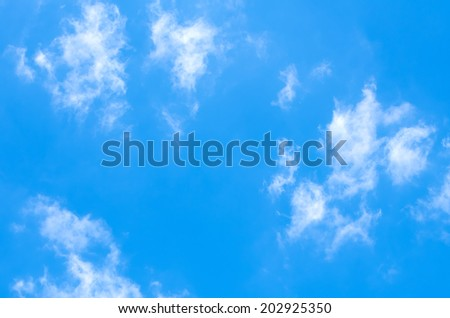Blue sky with fluffy white clouds - stock photo