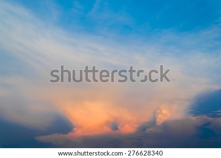 Blue sky with golden clouds