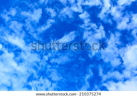 Blue sky with light clouds, may be used as background - stock photo