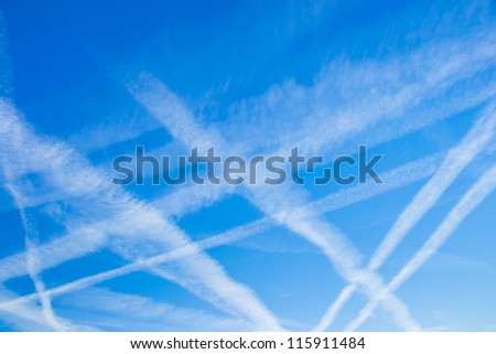 blue sky with many clouds lines made of aircraft - stock photo