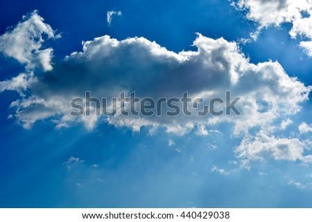 Blue sky with nice sun rays - stock photo