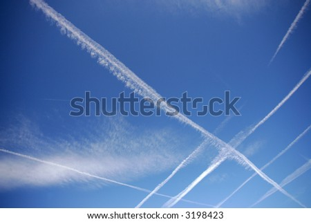 Blue sky with plane trails