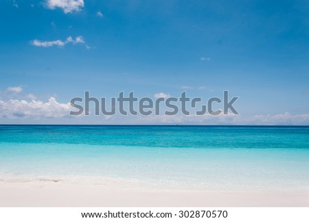 blue sky with sea and beach - soft focus with film filter - stock photo