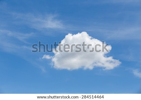 Blue Sky with single white cloud.