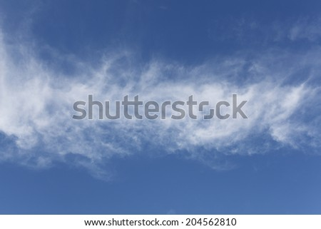 Blue sky with some white cirrus clouds - stock photo