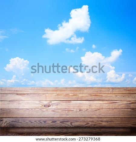 Blue sky with sun and beautiful clouds  for product montage texture background wallpaper. Stand for product showcase. - stock photo