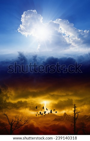 Blue sky with sun and dark red stormy sky with lightning, heaven and hell, good and evil - stock photo