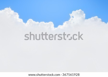Blue sky with sun and white clouds background - stock photo