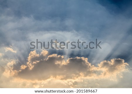 Blue sky with sunset / sunrise with clouds, light rays
