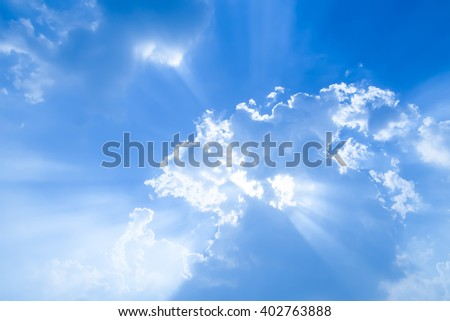 blue sky with tiny clouds and sun rays - stock photo